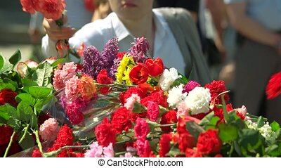 Big pile of flower bouquets. People put flowers in memory of...