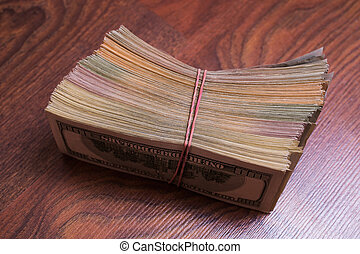 big pile of money. stack of money. related to money, money on the wooden background