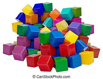 Big pile of plastic blocks isolated on white