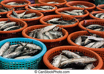 Big pile sea fish in basket on a fish market