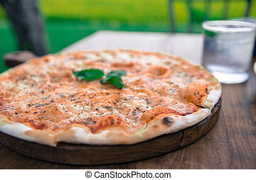 Big Pizza Margarita on wooden table