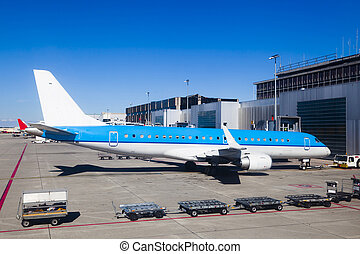 Big plane in an airport runway