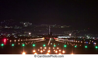 big plane landing at dusk at Osaka-Itami International...