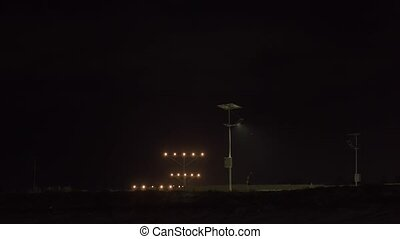 Big plane landing at night. airplane landing in airport.