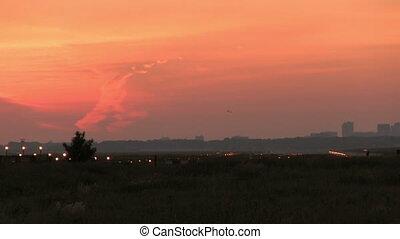 Big plane landing at sunset