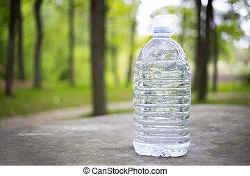 Big plastic bottle with water outdoor