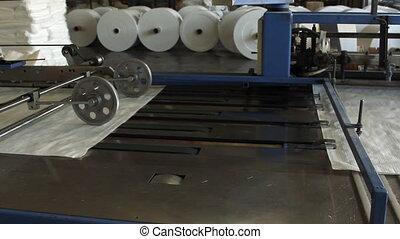Big polymeric tape roll unreel for a printing press