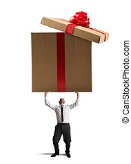 Big present - Businessman holding a big present on white...