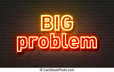 Big problem neon sign on brick wall background.