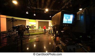 Big professional TV camera shoots people on TV show in Ostankino TV center, studio NTV