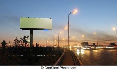 Big publicity board on road roadside comes nearer and...