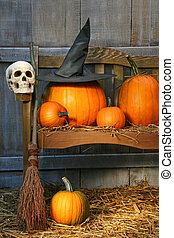 Big pumpkin with black witch hat and broom - Big pumpkin...