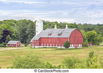 Big Red Barn - A large red barn with a tall white silo stand...