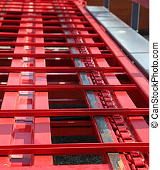 red conveyor belt in an international shipping industry