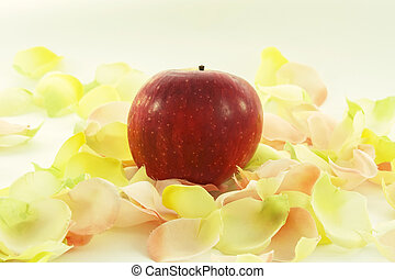 big red fresh apple with aromatic rose leave