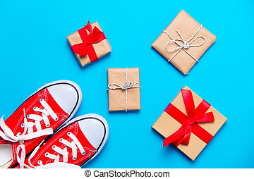 big red gumshoes and beautiful gifts on the wonderful blue background