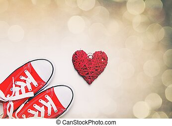 big red gumshoes and beautiful heart shaped toy