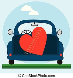 Big red heart on the blue car.