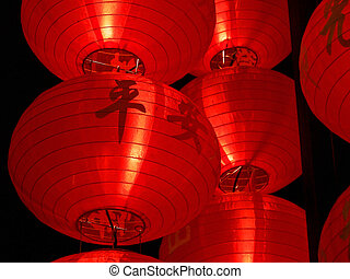 Big red lanterns with chinese letters printed. It brings...