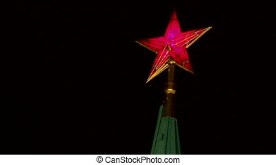 Big red star on the Spasskaya tower in Kremlin. Historic landmark in Moscow, Russia.