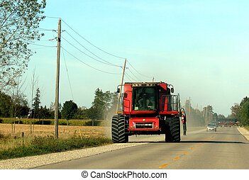 Big Red Tractor - A farmer driving a giant tractor along the...