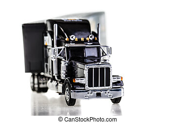 big rig - a black lorry model isolated over a white...