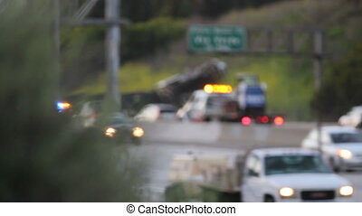 A accident on the freeway involving an overturned big rig.