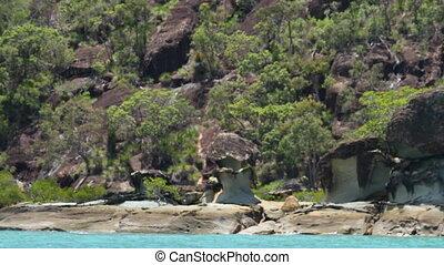 Big rock islands along side blue waters