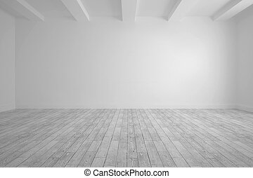 Big room with white wall and floorboards