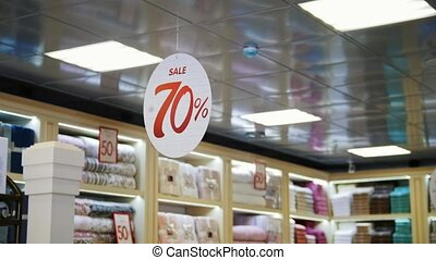 Big sale sign hanging in store of mall with discounts - Big...