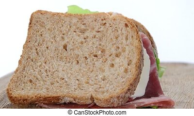 big sandwich with ham, chicken, cheese and tomato