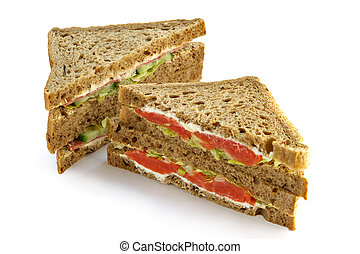 Big sandwich with a salmon, mayonnaise and leaves of green...