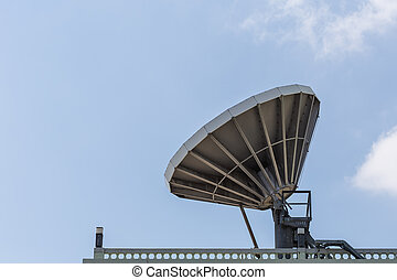 Big satellite dish on the roof with blue sky background