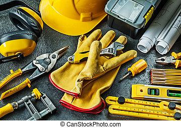 big set of construction tools on black background