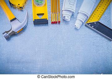 Big set of working tools on industrial metallic background