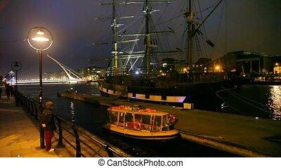 big ship is standing near evening wharf, Samuel Beckett...