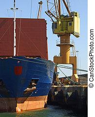 Big ship unloading in dock