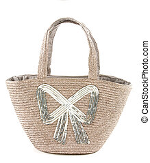 Big silver sequins bow raffia basket tote isolated on white background.