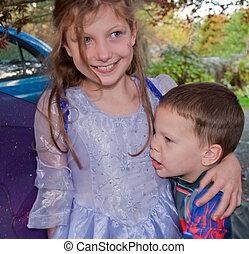 Big Sister Hugging Little Brother