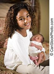 Big sister - Ten year old girl holding her newborn little ...