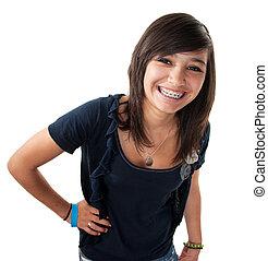 Cute hispanic teenage girl with braces and a big smile while hand on hip