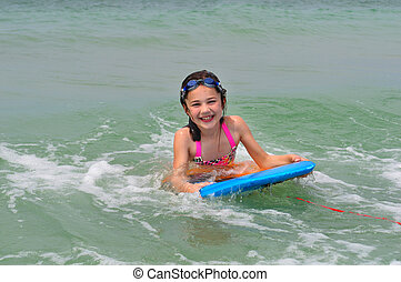 Big Smile While Riding a Boogie Board