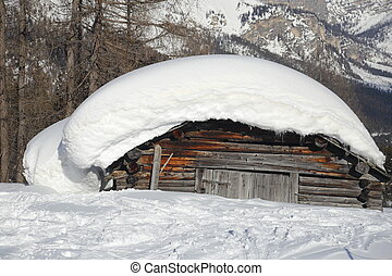 big snow cap on an old hovel