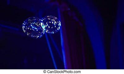 Big soap bubbles in night club