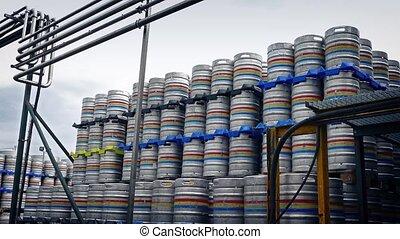 Big Stacks Of Barrels At Industrial Facility - Pan across...