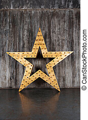Big star on the background of concrete wall