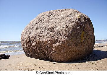 big stone on summer sea beach