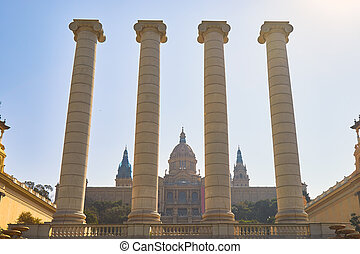 Big, strong stone columns on the street in Barcelona in Spain, hill Montjuic. In a background the National Museum of Catalonia.