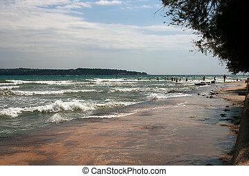 Big surf wave on the sea beach