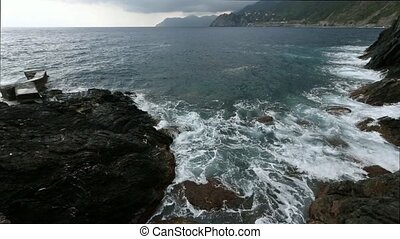 Big surf waves on Manarola coast, Cinque Terre, Italy - Big...